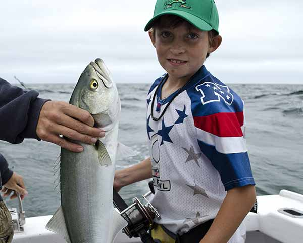 Kid on a Cape Cod fishing charter